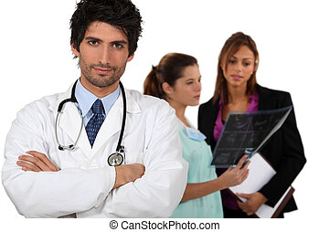 Doctor with medical staff in the background