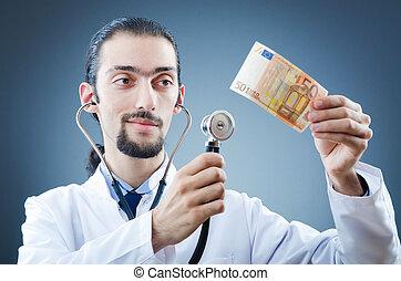Doctor with money in studio