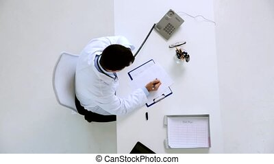 doctor with papers calling on phone at clinic - medicine,...