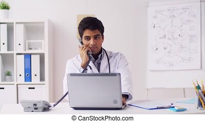 doctor with papers calling on phone at hospital - medicine,...