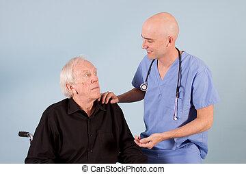 Doctor with patient - Bald doctor in scrubs with eldery ...