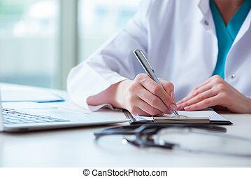 Doctor with prescribed medicines in medical concept
