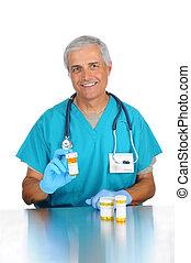Doctor with prescription bottles