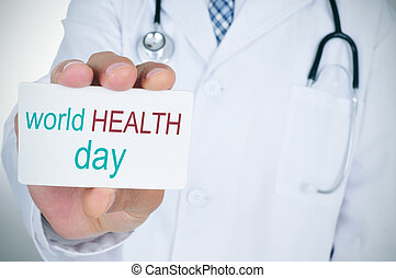 doctor with signboard with text world health day