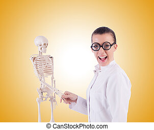 Doctor with skeleton on white