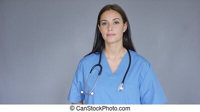 Doctor with stethoscope holding package - Smiling female...