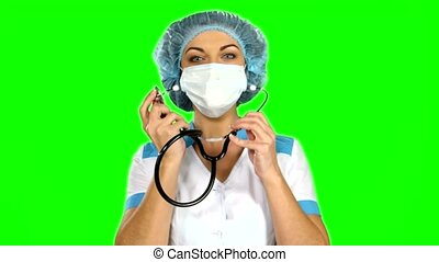 Doctor with stethoscope on green screen.
