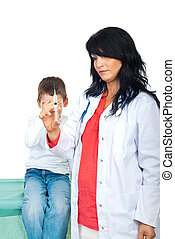Doctor with syringe and scared kid