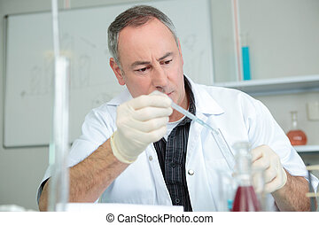 doctor with syringe is preparing for injection