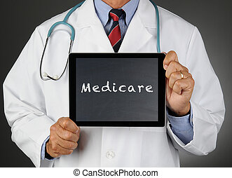 Doctor With Tablet Computer Medicare - Closeup of a doctor...