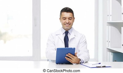 doctor with tablet pc and clipboard in hospital -...