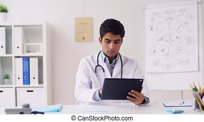 doctor with tablet pc and papers at hospital - healthcare,...