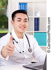 Doctor with thumb up - Portrait of young asian doctor with...