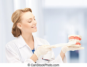 doctor with toothbrush and jaws in hospital - healthcare,...