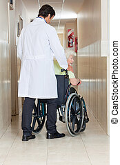 Doctor With Woman In Wheel