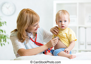 doctor woman examining child boy with stethoscope