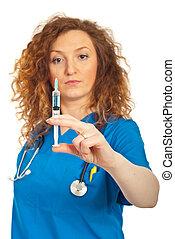 Doctor woman holding syringe