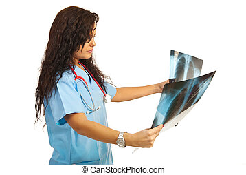 Doctor woman looking on xrays