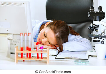 Doctor woman sleeping on office table