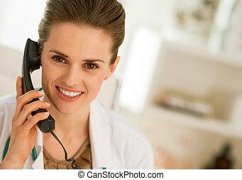 doctor woman talking phone