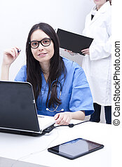 doctor woman with computer in hospital