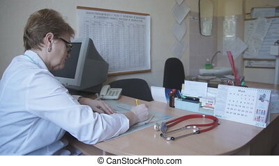 doctor working in the office