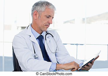 Doctor working with a tablet computer