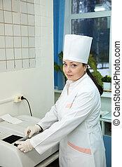 Doctor working with Biochemistry Analyzer