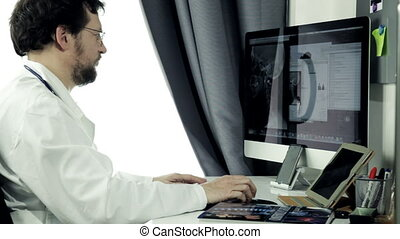 Doctor working with computer