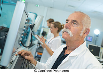 doctor working with screen