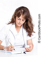 doctor writes a prescription for the patient