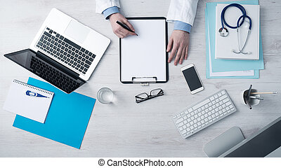 Doctor writing medical records - Professional doctor writing...