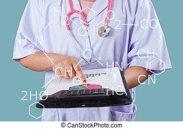 Doctor writing on clipboard for patient chart ,Healthy and technologies concept.
