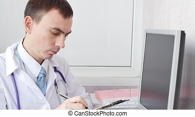 Doctor writing patient notes on a medical examination
