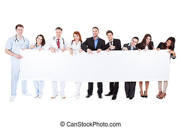 Doctors and managers showing empty banner