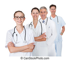 Doctors and nurses - Row of smiling diverse medical doctors...
