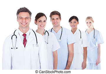 Doctors And Nurses Standing In A Row - Happy Group Of...