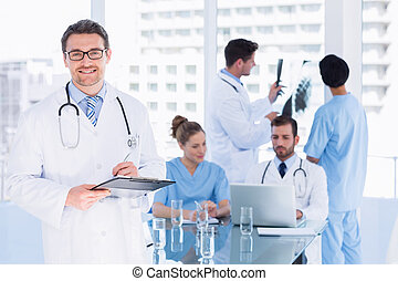 Doctors at work in medical office - Concentrated doctors at...