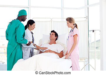 Doctors caring for a patient