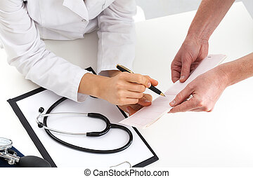 Doctors comparing health check-up - Pair of doctors...