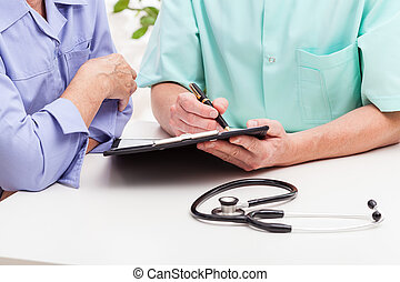 Doctor's consultation - A doctor's consultation with his...