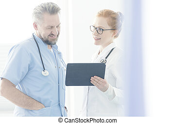 Doctors consulting medical issue