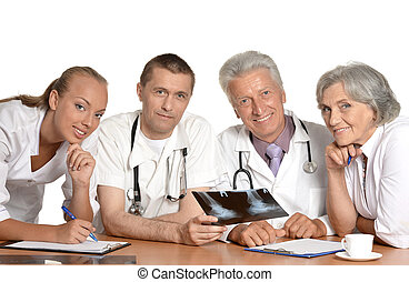 Doctors discussing at table