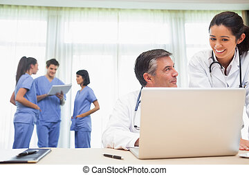 Doctors discussing something during meeting