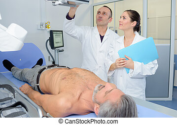 doctors examinating a patient at the hospital