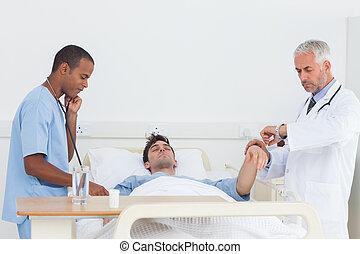 Doctors examining a patient