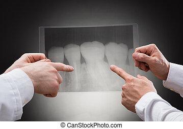 Doctors Examining Dental Xray