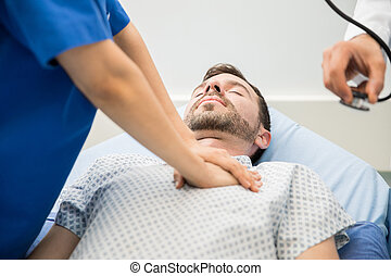 Doctors giving CPR to a patient