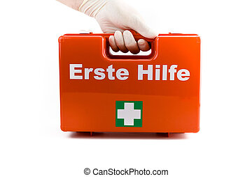 Doctors hands in white medical gloves holding first aid kit isolated on white background