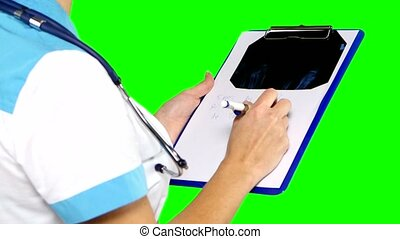Doctor's hands with a table on green screen